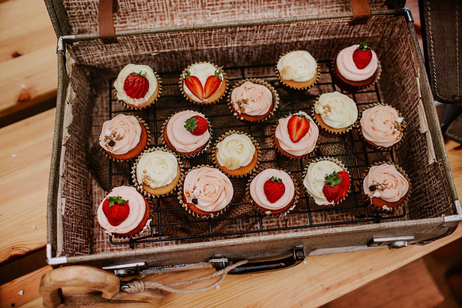 Pretty cupcakes in a basket