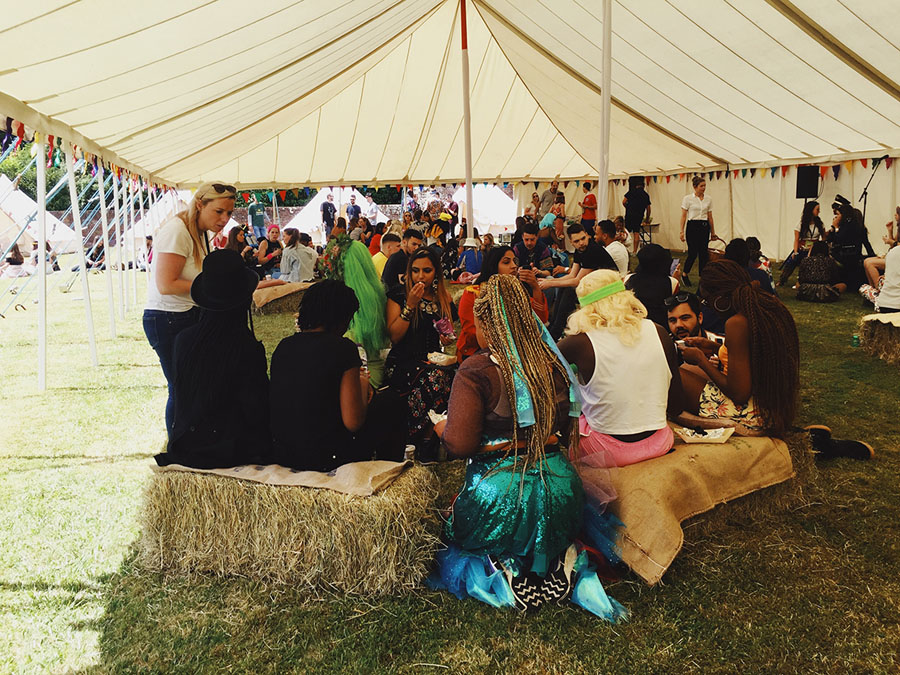 Group of people socialising in a marquee