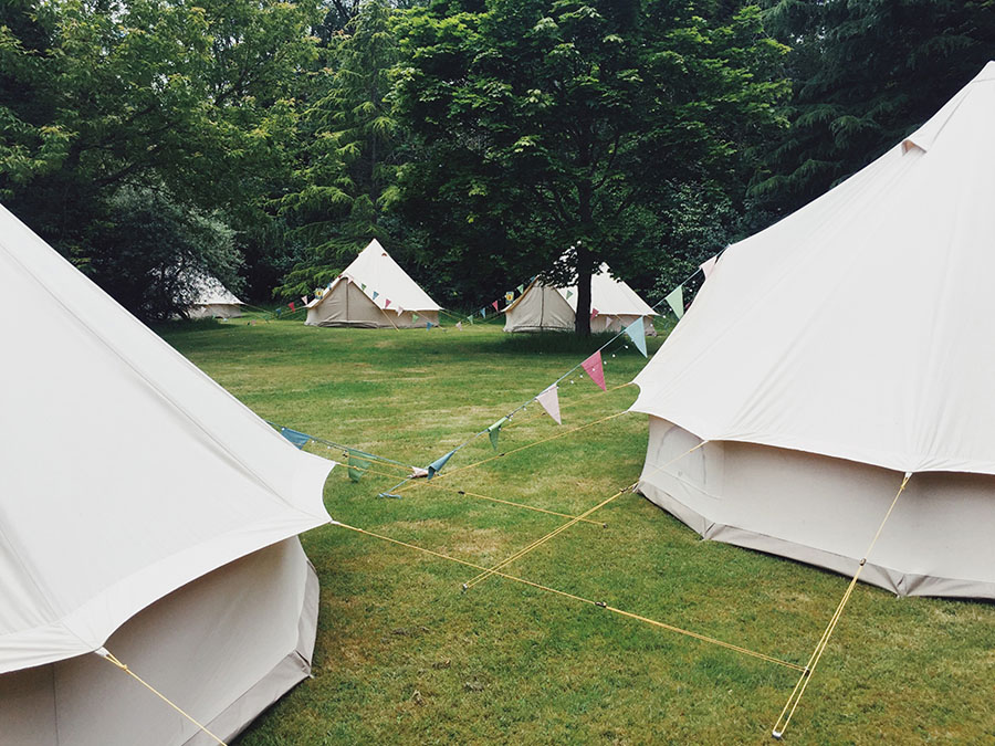 bell tents in a countryside space