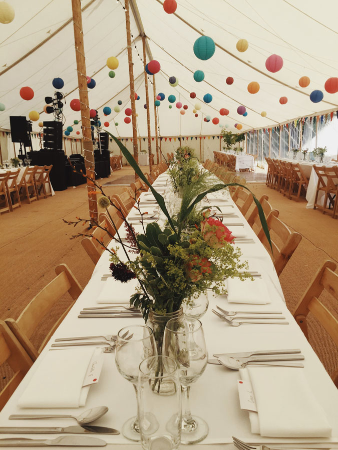 Decorated marquee with bunting and lanterns