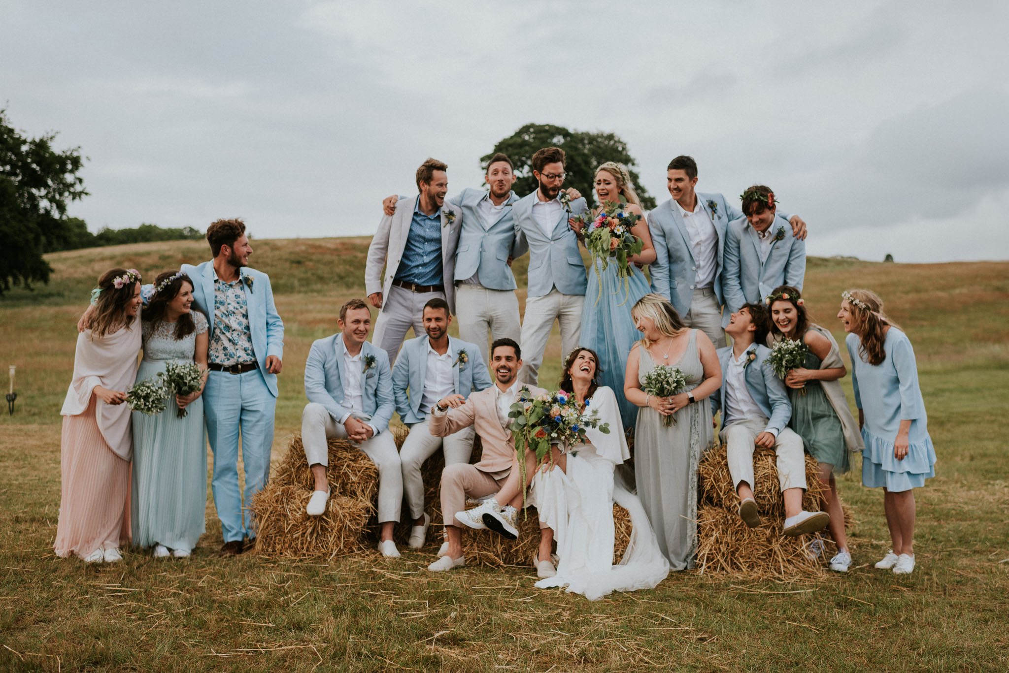 wedding party with bride and groom in a field