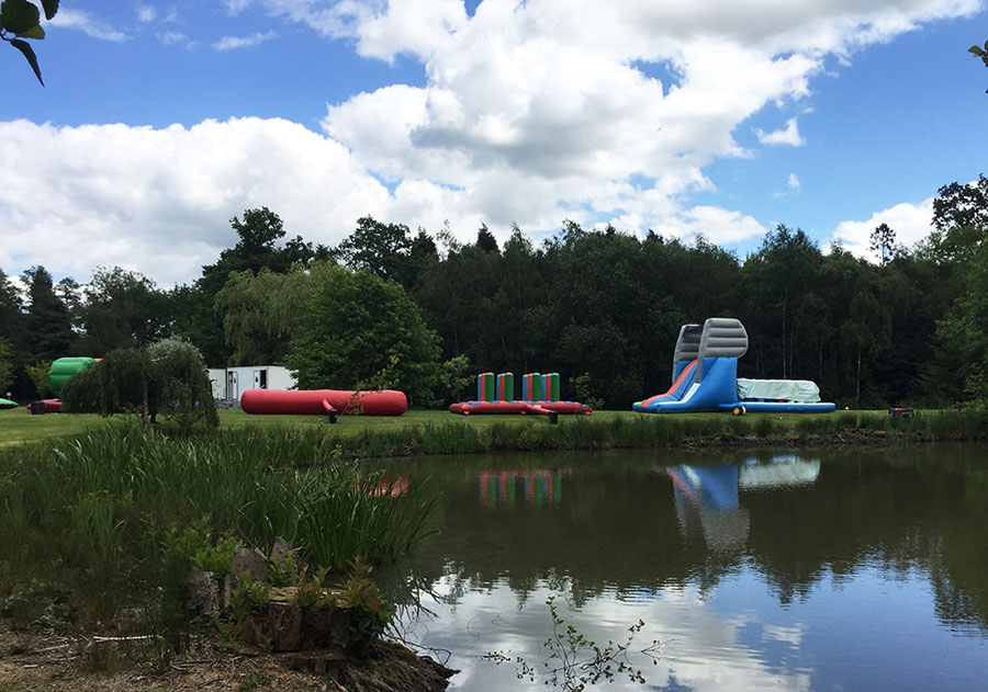 inflatables set alongside a lake