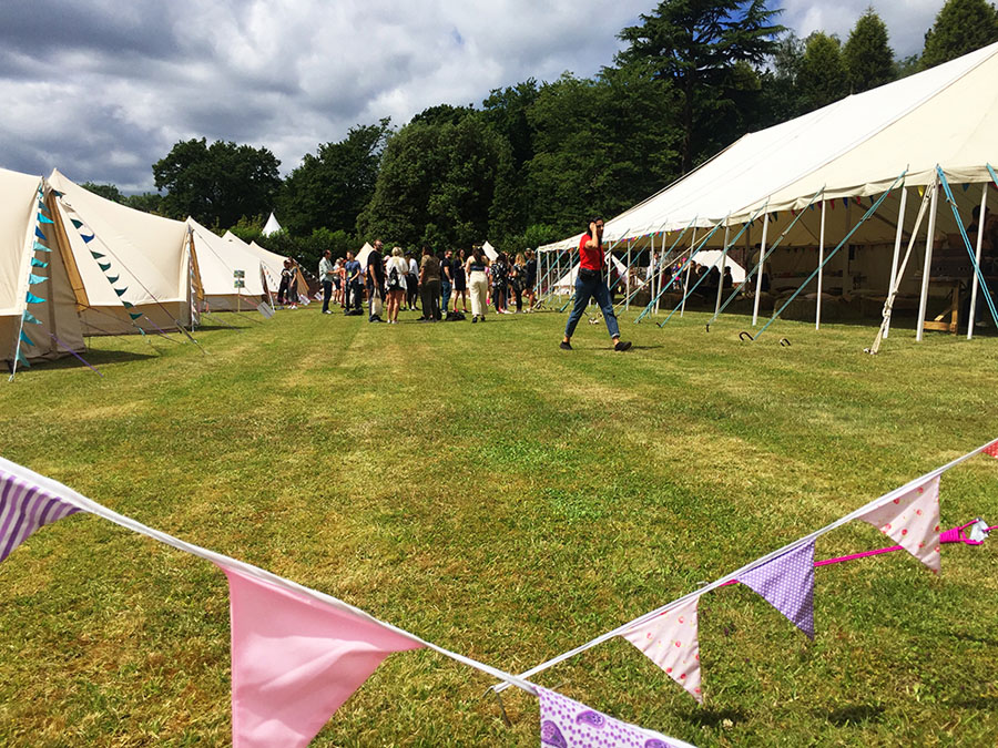 bell tents and marquee in a field