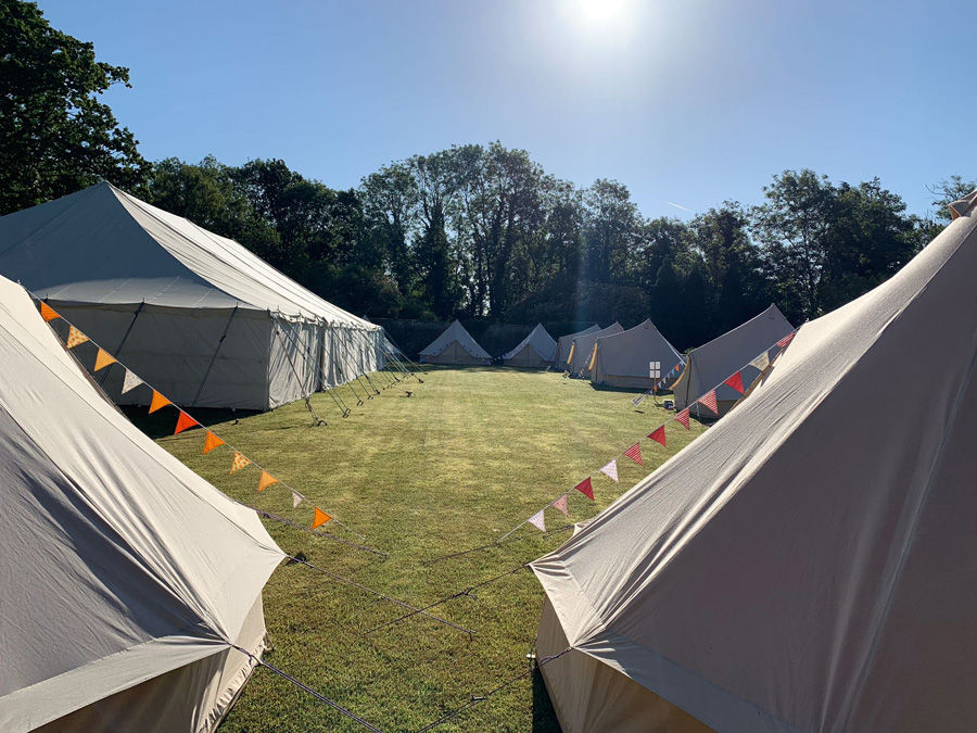 marquee and bell tents in a field