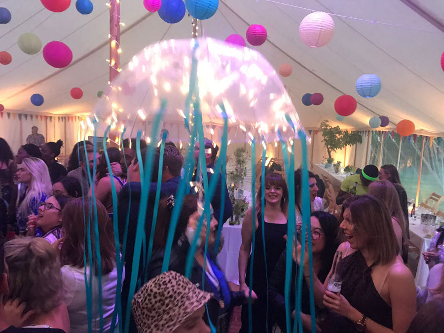 people dancing in a marquee