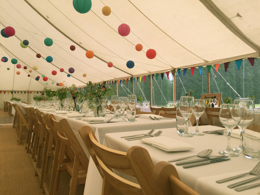 Marquee styled with bunting and paper lanterns