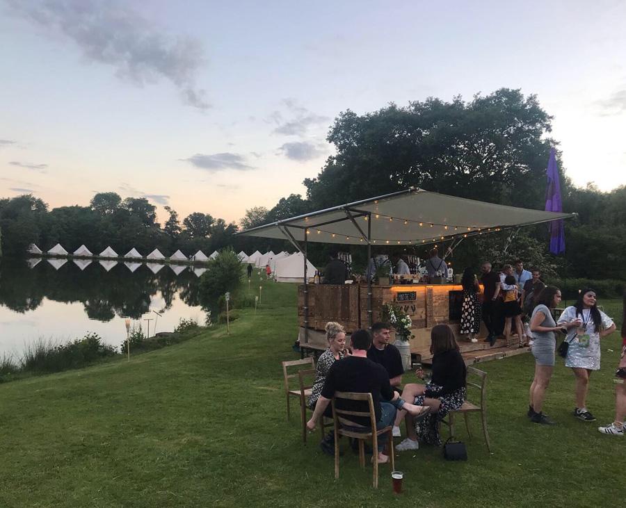 outdoor bar next to a lake