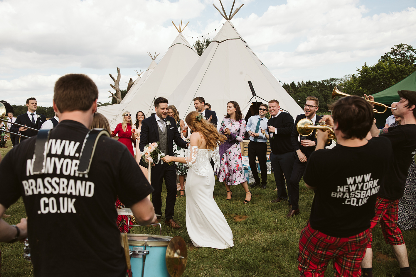 newly wed couple dancing outside a tipi