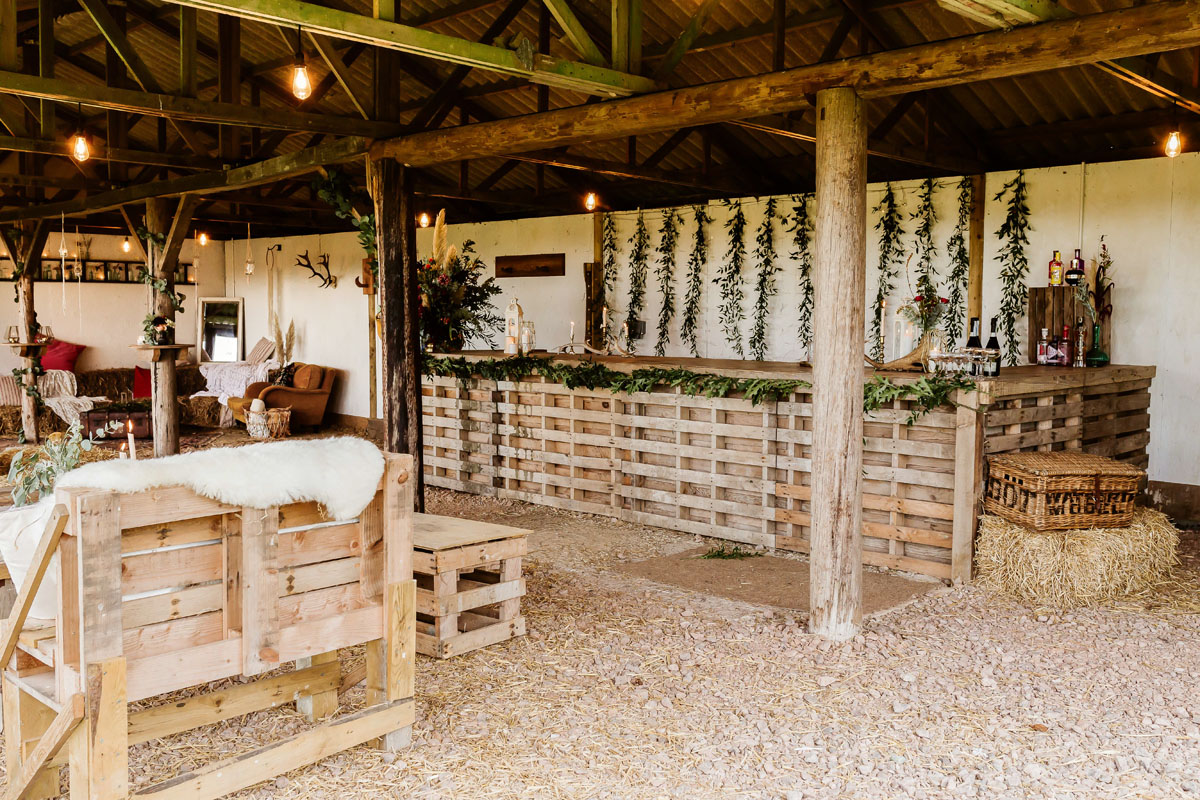 rustic barn styled with foliage