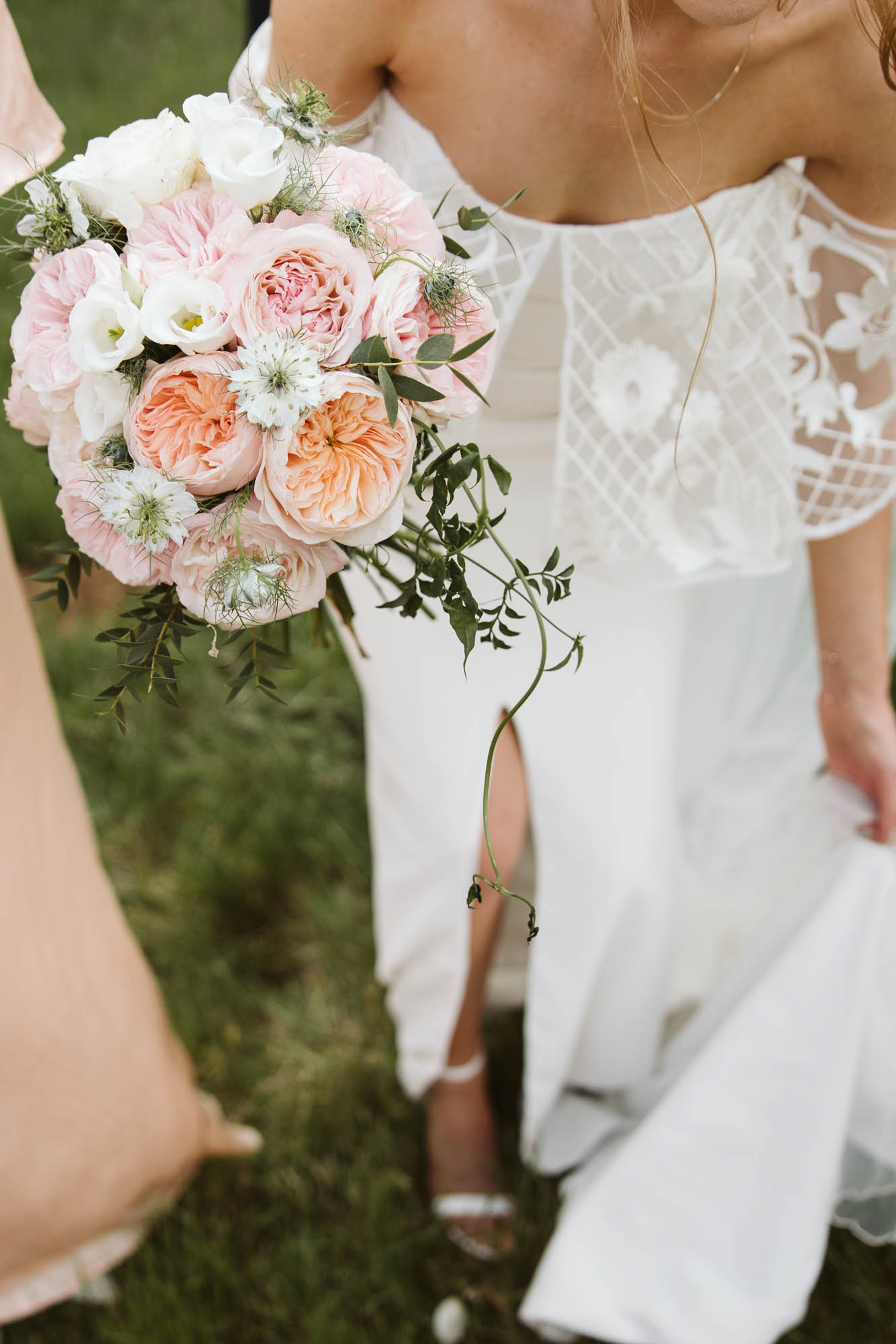 Bride with lace dress and peach bouquet