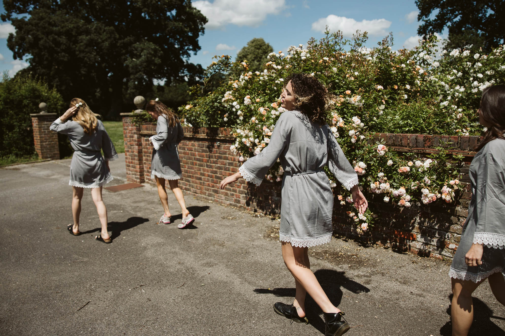 bridesmaids in dressing gowns in the road