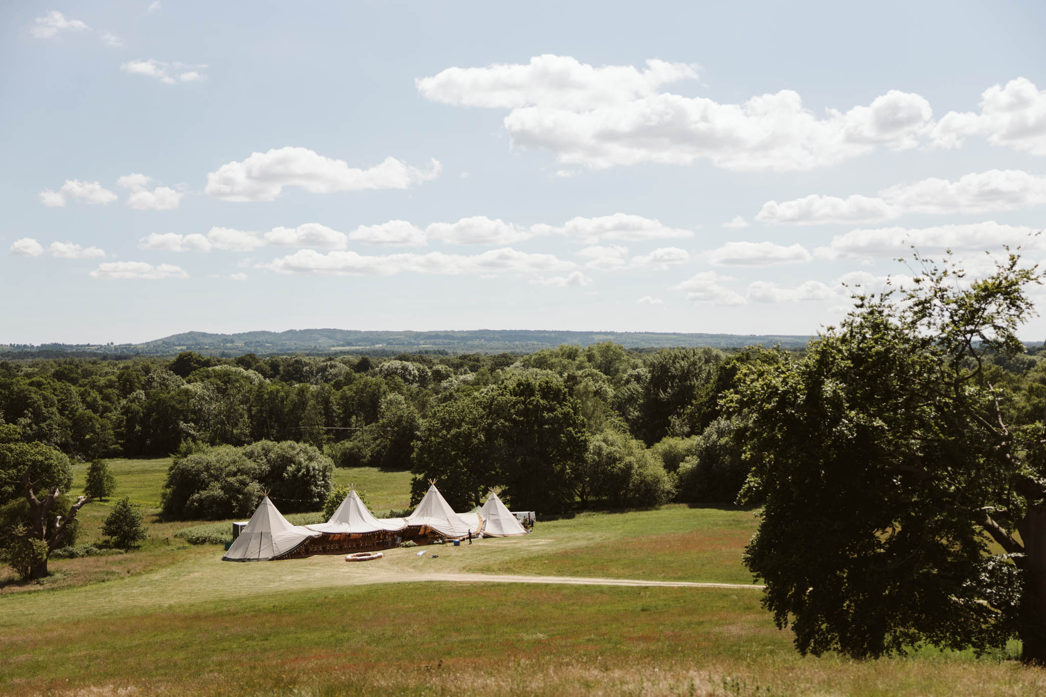 row of tipis in a field