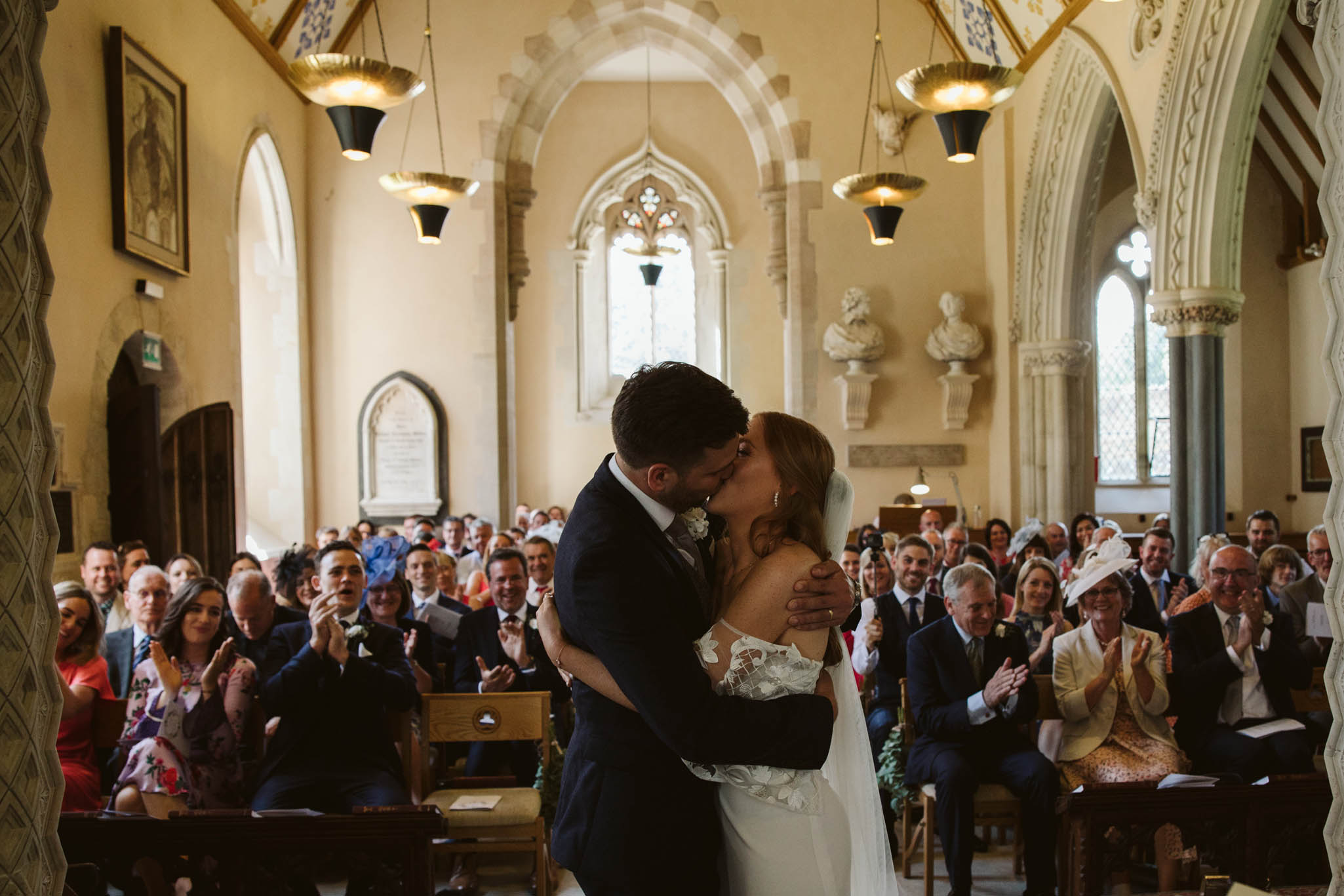 newly weds kissing in church