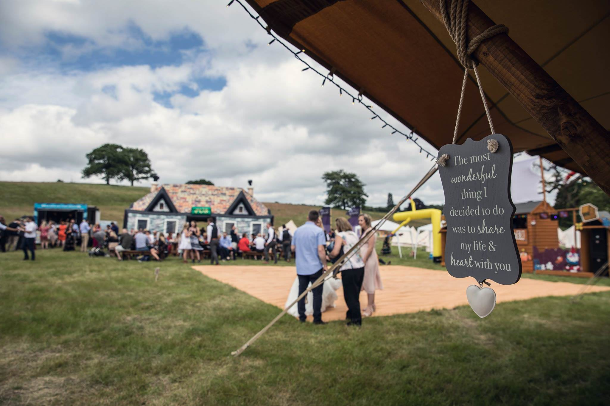 photo taken from tipis looking out to a festival wedding at fiesta fields surrey