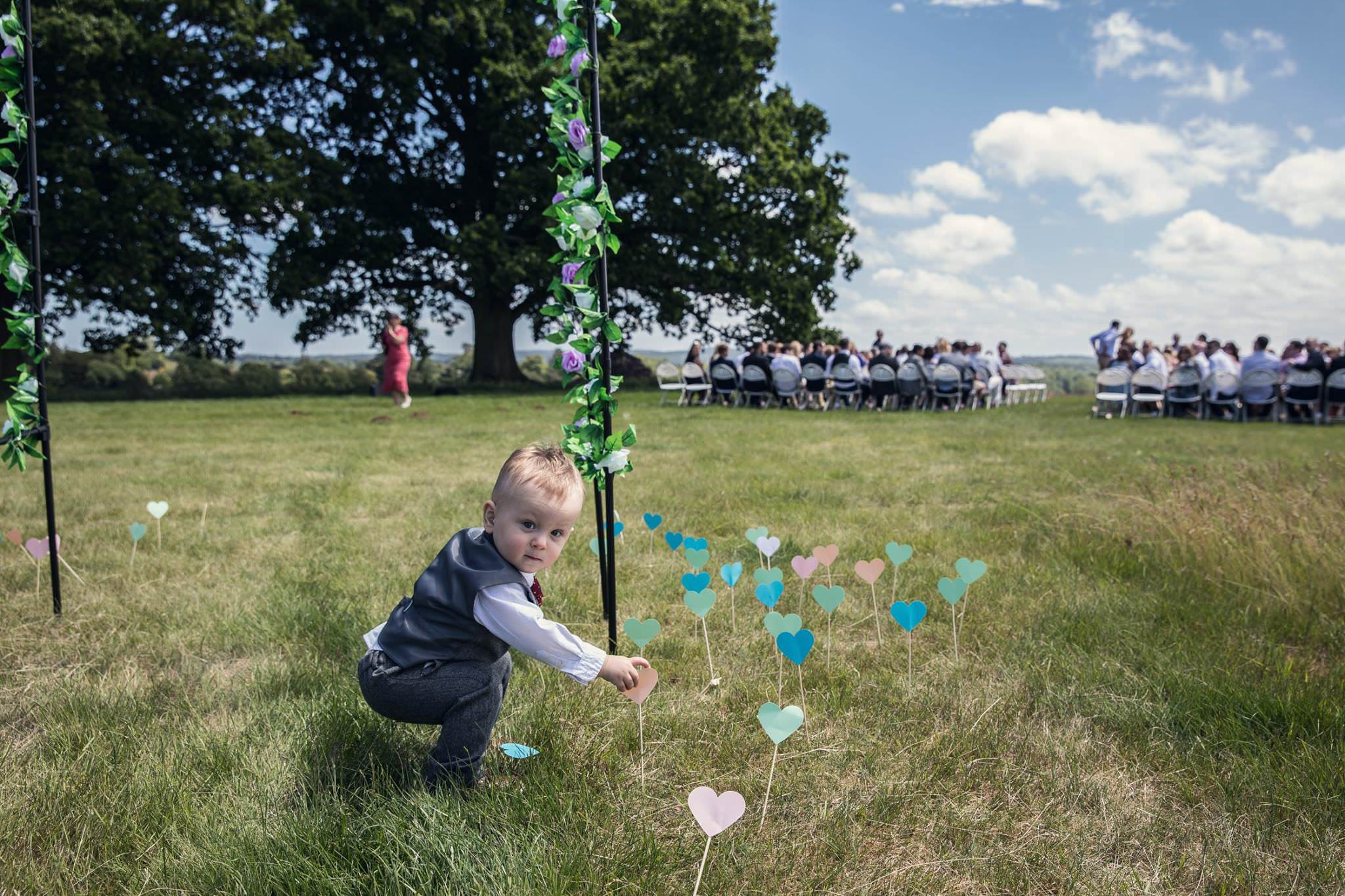 little boy at outdoor wedding ceremony