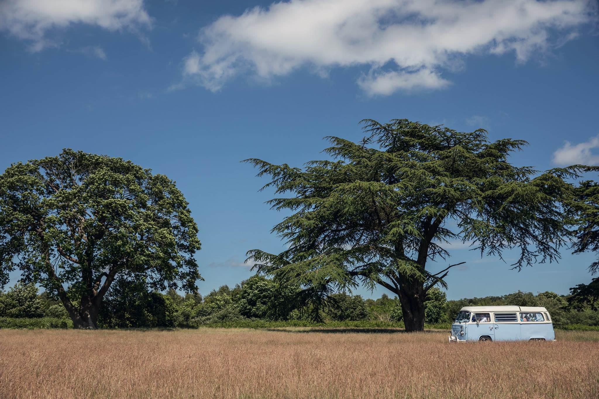 campervan arriving at a wedding with bride and bridesmaids