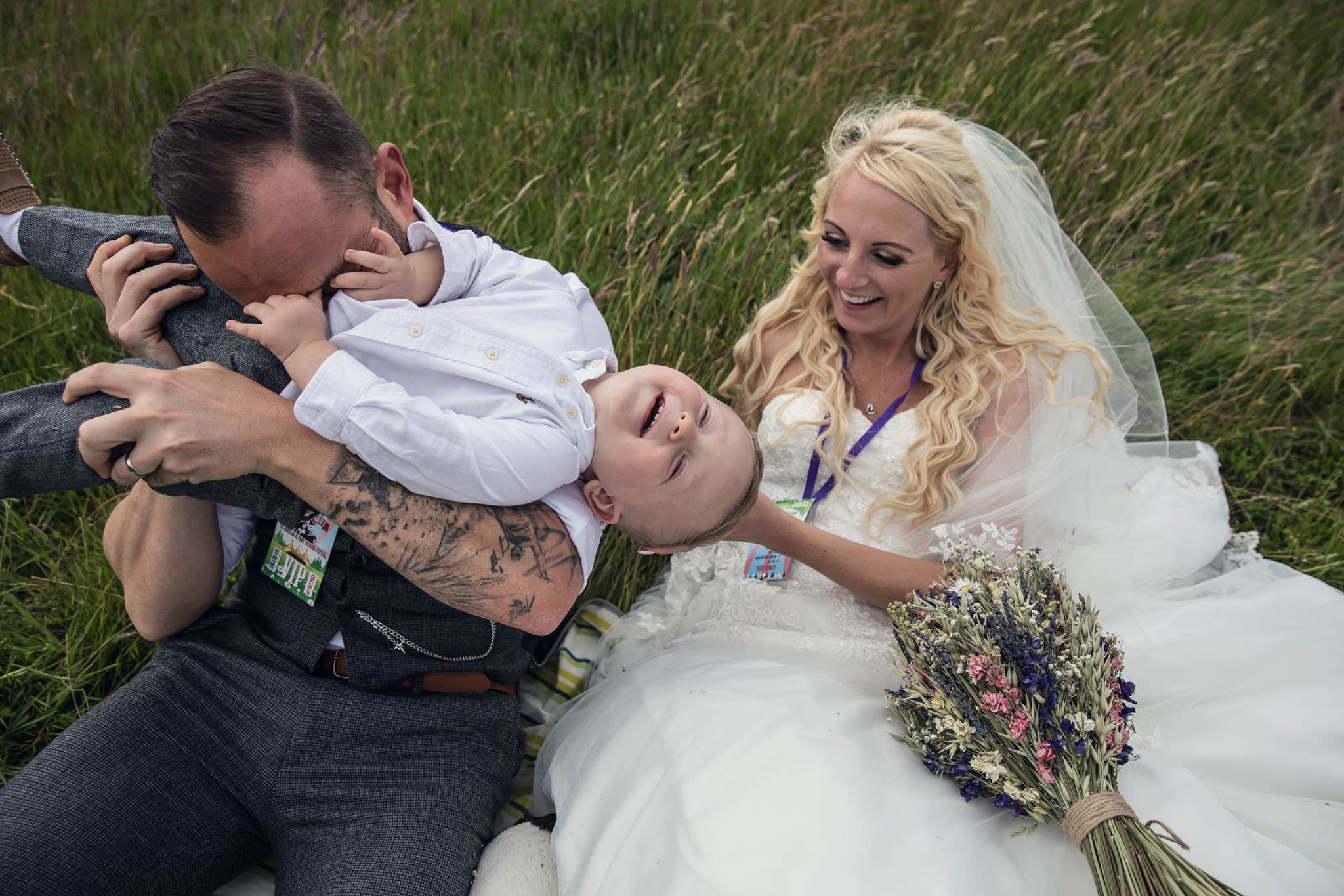 couple and little boy at their festival wedding