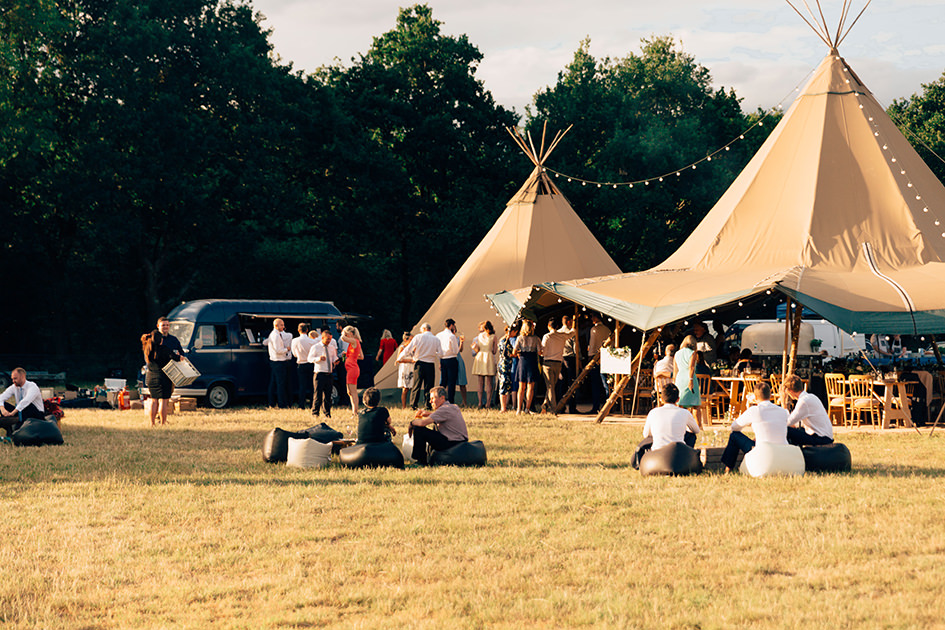 tipi in a field on a sunny day