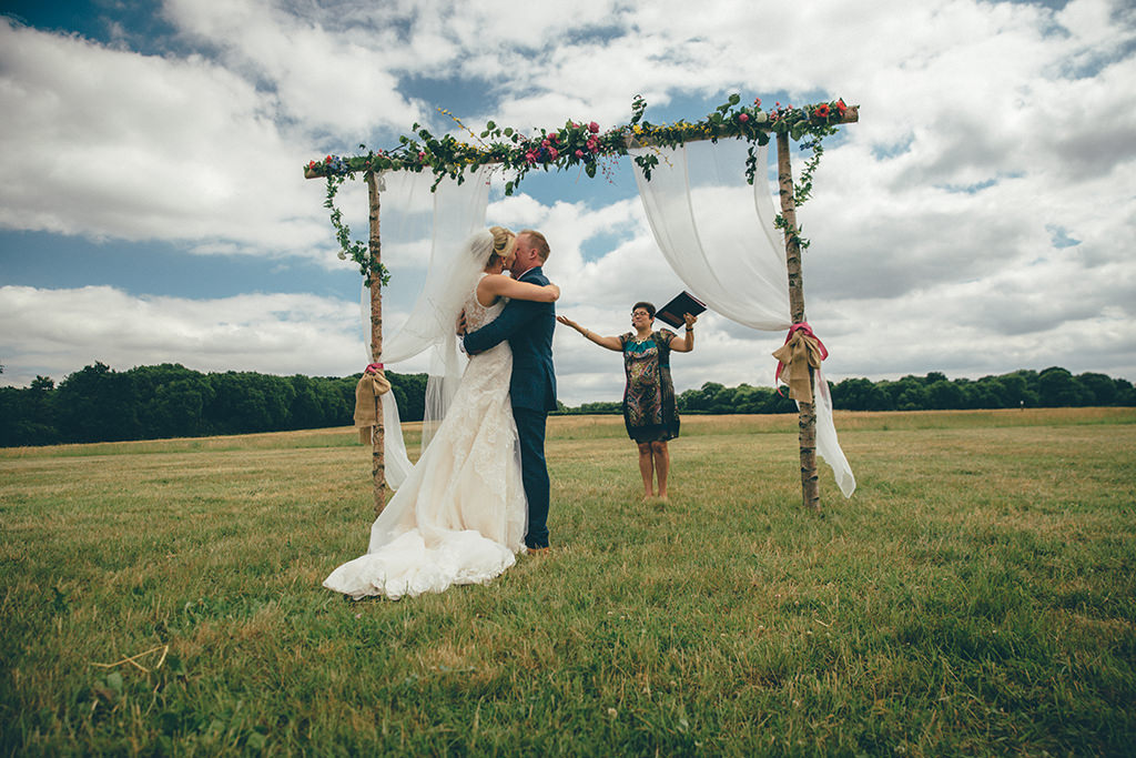 couple just married at an outdoor ceremony
