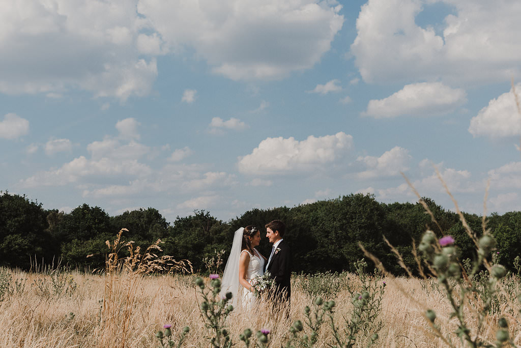 couple in a field just married