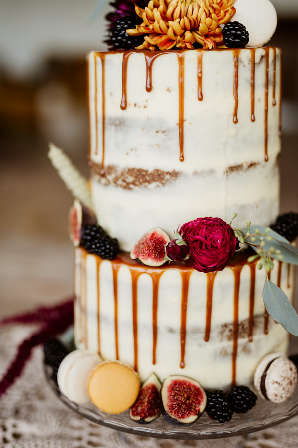 gorgeous wedding cake with drizzle running down the side