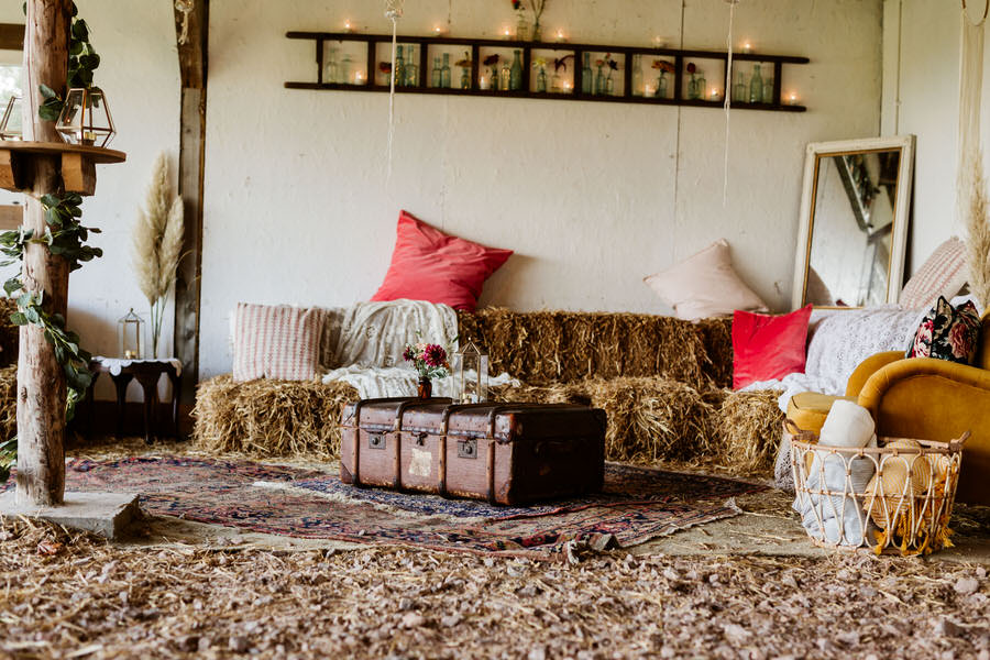 rustic barn styled with soft furnishings and hay bales