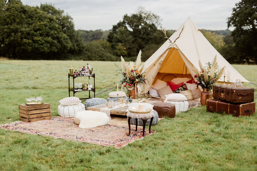 bell tent with seating area outside boho styling
